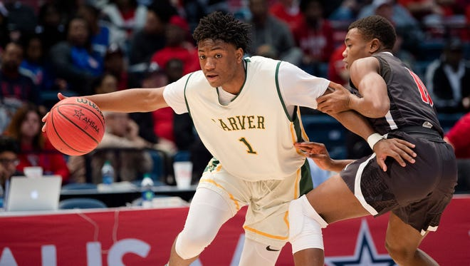 Carver-Montgomery's Jaykwon Walton drives on Hazel Green's Ben Pitts during the AHSAA Class 6A State Semifinal game between Carver-Montgomery and Hazel Green on Friday, Feb. 28, 2018, in Birmingham, Ala.