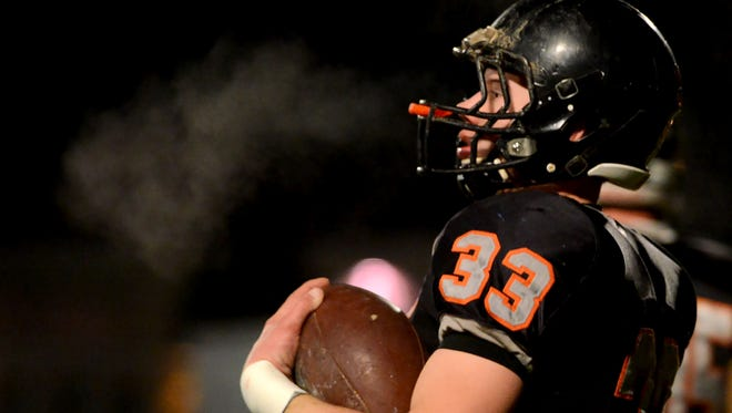 Silverton's Sam Kuschnick (33) takes a breath of the cold air before the start of the Ashland vs. Silverton OSAA Class 5A quarterfinal football game at Silverton High School on Friday, Nov. 14, 2014.