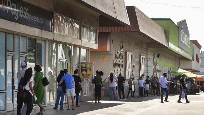 Patrons line up, practicing social distancing, outside the a Whole Foods Market in California in May.