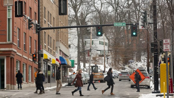 Pedestrians cross against the traffic light at the