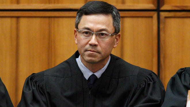 U.S. District Judge Derrick Watson, shown here in a file photo, issued a nationwide halt to President Trump's travel ban on March, 15, 2017, hours before it was set to take effect.