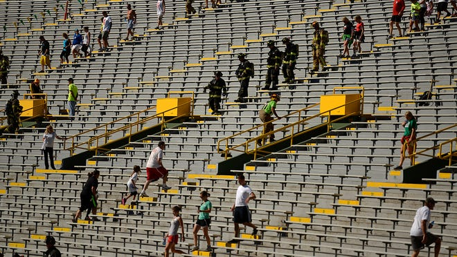 People take part in the 9/11 Memorial Stair Climb at Lambeau Field in Green Bay.