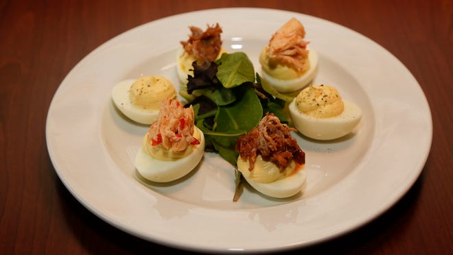 All photographs taken at the Coach Lamp on Vine Street in Louisville.  This is a deviled egg sampler plate. November 5,  2014
