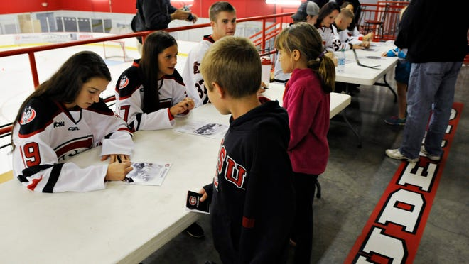 Members of the St. Cloud State men's and women's hockey teams signed autographs and talked with fans during a caravan stop at the Moose Sherritt Arena Tuesday in Monticello.