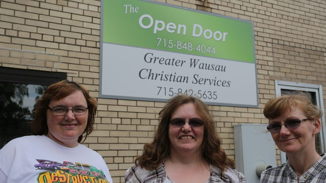 From left, coordinator of the Partner Project Anne Drow and volunteers Rachel Werner, Merrill, and Mary Stankowski, Marathon, stand outside The Open Door in downtown Wausau. The Partner Project is a new mentoring program by the organization, which provides services and support to those who have been incarcerated.