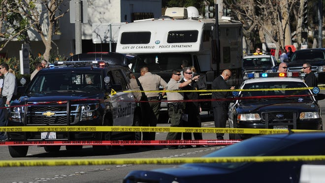 Investigators are shown at the scene where Bryant Duncan, 23, was shot in December 2015 by a sheriff's deputy near Carmen and Daily drives in Camarillo.