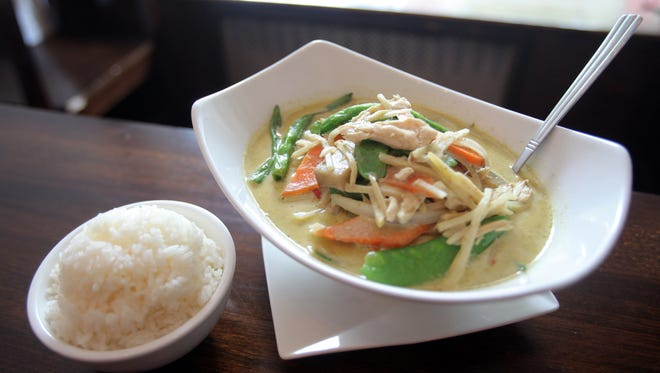 Thai Green Curry with rice is a dish served at Dumpling + Noodle in Bronxville June 25, 2014.
