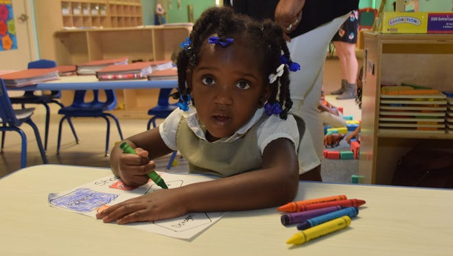 Destinee Jones colors an art project in a class at the Save the Children Head Start center on McKeithen Drive. Her classmates are Jamarcus Malte, Kaeden Lowe, D'Andre Berry, Kennedy Bell, Rickie Ross, Dominik G. Hines, Kazmei Stewart and A'Crista Blake.