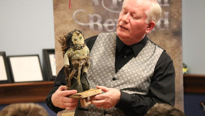 Jim Kleefeld, entertainer from Avon, gave local teens a chance to try their hand at voodoo during his 'Tales From Beyond' program at Ida Rupp Public Library.