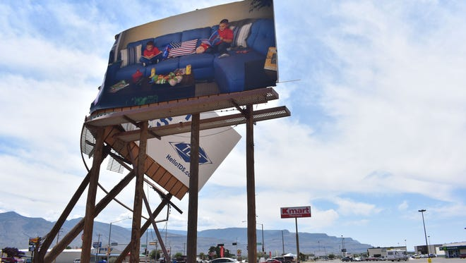 In the aftermath of Wednesday's storm, a billboard in the parking lot of the White Sands Mall was snapped in half by 60 mph winds.