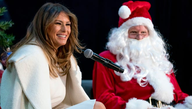 First lady Melania Trump and Santa Claus, as she takes questions from children before reading 'The Polar Express' at Children's National Medical Center, Dec. 7, 2017, in Washington.