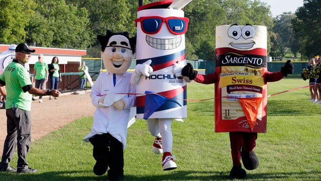"""Plenco's """"Crazy Chemist"""", left, Rockline's """"Capt. Clean"""" and Sargento's """"Sarge"""" compete during the United Way kickoff Thursday September 17, 2015 at Wildwood Baseball Park in Sheboygan."""