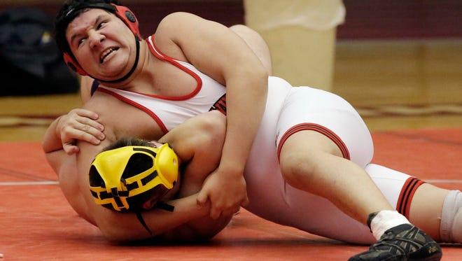 Sheboygan South's Jonathon Zapata, top, wrestles Sheboygan North's Ryu Yang in a 220-pound match Feb. 4.