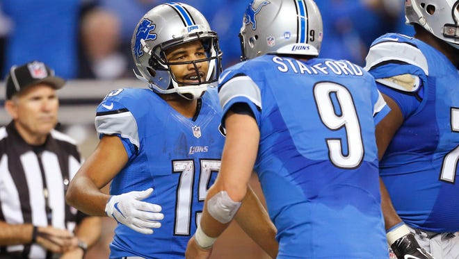Lions wide receiver Golden Tate (15) is congratulated by quarterback Matthew Stafford (9) after scoring a touchdown during the first half against the Philadelphia Eagles on Nov. 26, 2015.
