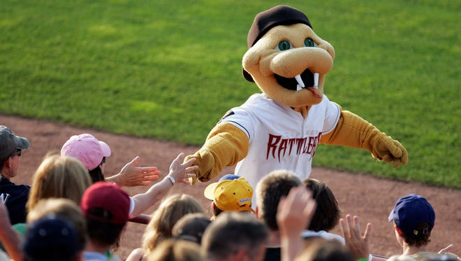 Fang works the crowd at a Wisconsin Timber Rattlers game.