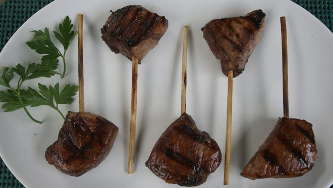 Grilled Pork Lollipops prepared at the home of the Test Kitchen writer Sue Selaskey Monday, July 12, 2010. 
