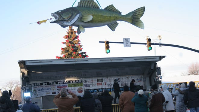 Onlookers are bundled up as they brave the freezing temperatures to see the brand new Wylie Walleye unveiled in Port Clinton for the annual New Year's Eve Walleye drop on Sunday night.