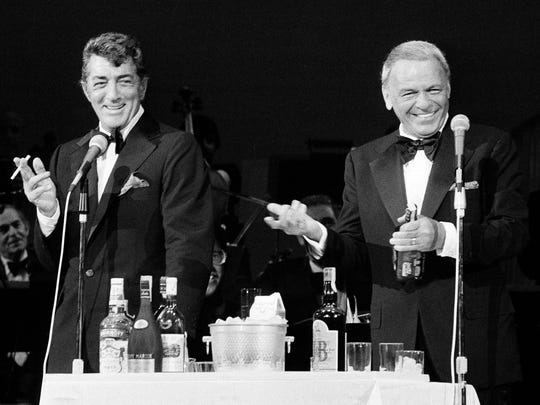 In this May 18, 1977 file photo, performers Frank Sinatra, right, and Dean Martin mix drinks on the stage of the Westchester Premier Theater in Tarrytown, N.Y., during the opening night of their act.