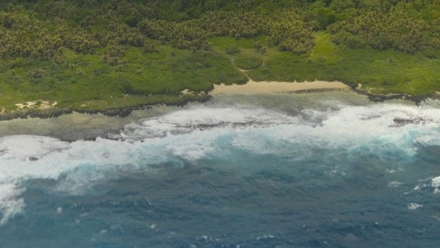 The ocean churns along a southern reef in this photograph taken from a flight above the island.