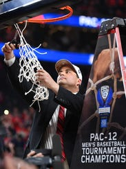 Arizona coach Sean Miller cuts the net after defeating USC to win Pac-12 Tournament.