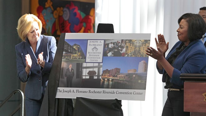 Monroe County Executive Maggie Brooks, left, and Rochester City Mayor Lovely Warren, right, unveil a sign during a renaming ceremony in honor of Joseph Floreano.