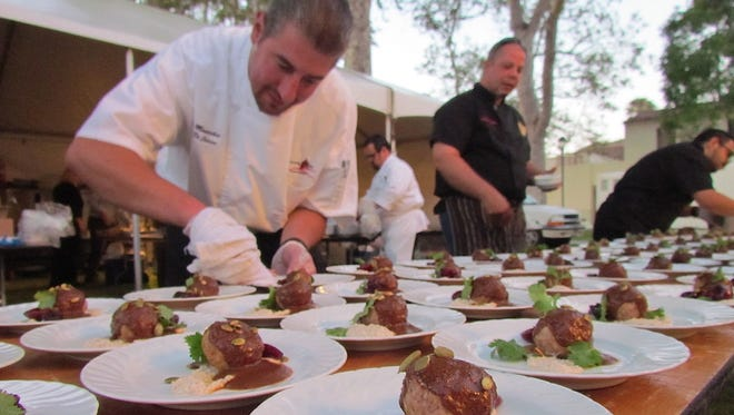 Nic Manocchio, chef de cuisine for University Auxiliary Services at CSU Channel Islands, helps plate a course during the inaugural Yummie Top Chef Dinner in 2014. The fundraiser for Casa Pacifica Centers for Children & Families will return to the Camarillo campus on May 31.