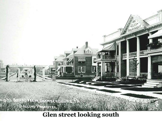 Looking south on Glen Street, with the Glen Apartment Building on the right.