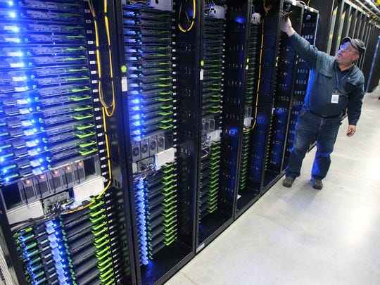In this Oct. 15, 2013, photo, Chuck Goolsbee, site director for Facebook's Prineville data centers, shows the computer servers that store users' photos and other data, at the Facebook site in Prineville, Ore. Facebook has chosen a village on the edge of New Mexico's largest metropolitan area as the location for its new data center, an announcement that spread quickly Wednesday, Sept. 14, 2016, as elected officials celebrated a hard-sought win that could have ripple effects for the state's struggling economy. News of the social media giant's decision to build in Los Lunas, just south of Albuquerque, comes after a roller-coaster contest between New Mexico and Utah to attract the facility.