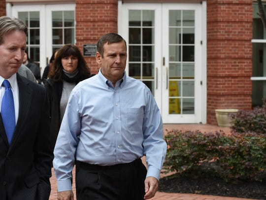 Scott Wombold, right, former vice president of direct sales at Pilot Flying J, leaves court Tuesday, Feb. 9, 2016.