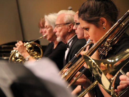 The brass section from the San Juan College Orchestra performs during a concert in November in Farmington.