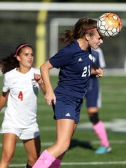 Chatham's Katie Helman heads the ball away from Morris