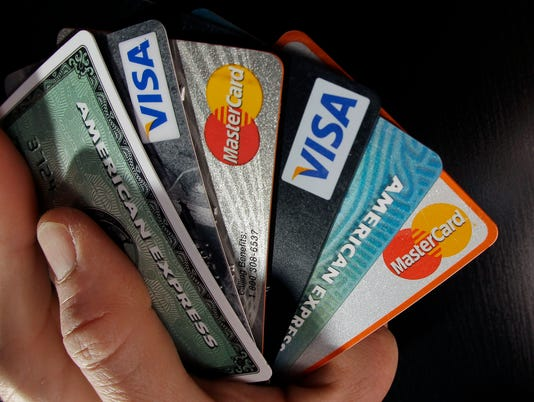 AP ON THE MONEY-CREDIT CARD ANNUAL FEES F A FILE USA MA