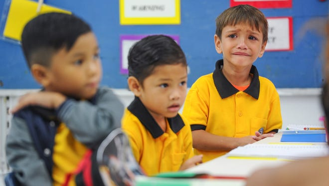 Tears begin to flow as kindergartener Jacob John Mendiola looks around the classroom for his parents during the first day of public school classes at Chief Brodie Memorial School in Tamuning on Thursday, Aug. 18, 2016.