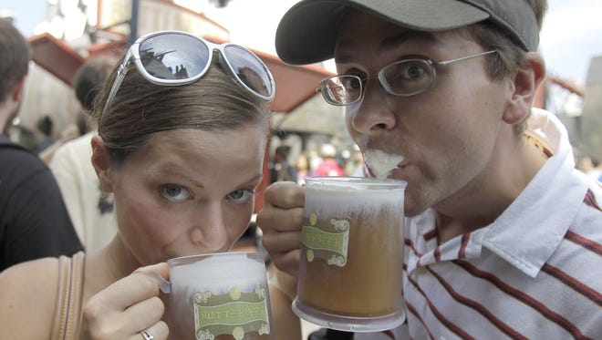 This June 18, 2010 file photo shows park guests Jillian Woodworth, left, and Steven Hopke as they try Butterbeer at the grand opening of the Wizarding World of Harry Potter at Universal Orlando.