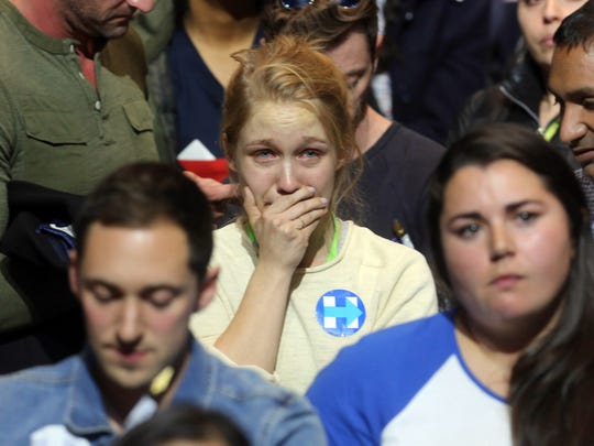 Nov 8, 2016; New York, NY, USA;    A Hillary Clinton supporter cries as she watches election returns at the Jacob K. Javits Convention Center on election night.  Mandatory Credit: Seth Harrison-USA TODAY NETWORK