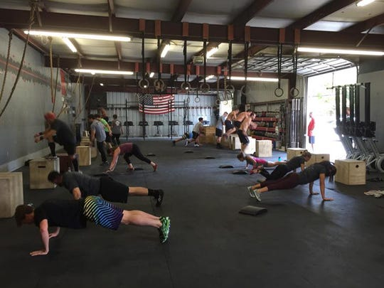 Athletes at Ragin' CrossFit participate in WOD with