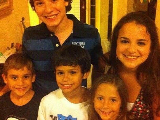 Back: Left to right: Content Producer Jose A Bastidas and Gabriela Bastidas.  Front: Left to right: Nicolas Tapia, Carlos Tapia and Sofia Bastidas.  The siblings pose together during a family reunion in 2012. The last time they've all been in the same room together.