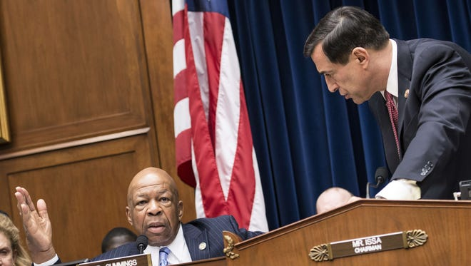 Committee chairman Rep. Darrell Issa, R-Calif., cuts off the microphone of ranking Democrat Rep. Elijah Cummings, D-Md., during a hearing of the House Oversight and Government Reform Committee on Wednesday.