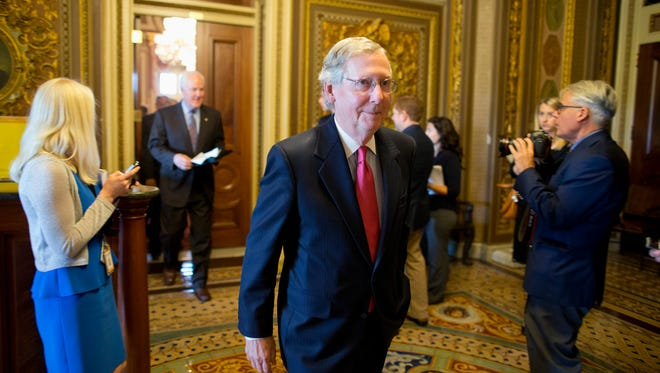 Senate Minority Leader Mitch McConnell walks to the Senate floor on Capitol Hill on Oct. 8, 2013.