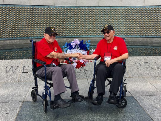 "World War II veterans Walter ""Kent"" Perry, 90, left, and Vito Mastrangelo, 92, both of Visalia, shake hands in front of a wreath at the World War II Memorial in Washington, D.C."