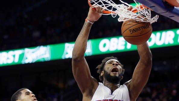 Pistons center Andre Drummond, right, dunks on Magic