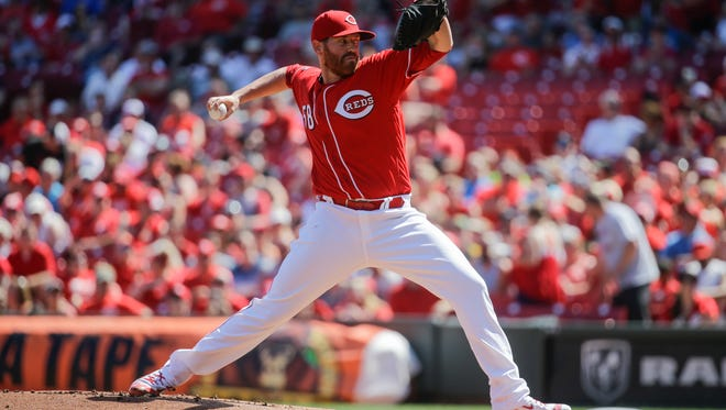 Cincinnati Reds starting pitcher Dan Straily throws in the first inning of the baseball game against the Oakland Athletics, Saturday, June 11, 2016, in Cincinnati.