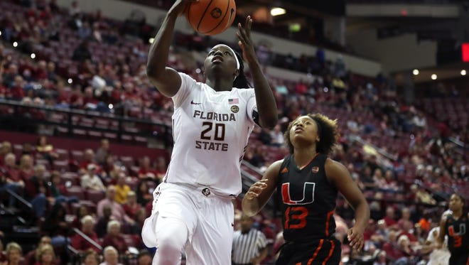 FSU's Shakayla Thomas lays the ball up against Miami during their game at the Civic Center on Thursday, Jan. 11, 2018.