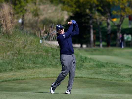 Tom Watson hits a fairway shot on the ninth hole during the second round of the 75th Senior PGA Championship golf tournament at Harbor Shores Golf Club in Benton Harbor, Mich., Friday, May 23, 2014. (AP Photo/Paul Sancya)
