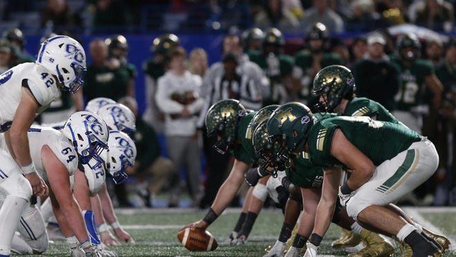Blessed Trinity offense start their final drive to run out the clock during the GHSA high school football AAAA state championship game between Blessed Trinity and Oconee County on Saturday, Dec. 14, 2019, in Atlanta. Blessed Trinity won 17-14.