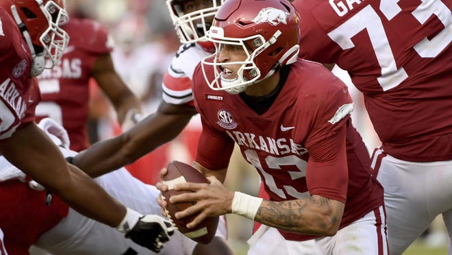 Arkansas quarterback Feleipe Franks (13) scrambles out of the pocket during the second half of the team's NCAA college football game against Georgia in Fayetteville, Ark., Saturday, Sept. 26, 2020.