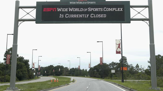 A sign at the entrance to ESPN's Wide World of Sports at Walt Disney World in Kissimmee, Fla., as things stood Wednesday, before the NBA's board of governors voted Thursday to resume play at the complex beginning July 31.