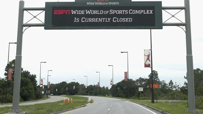 A sign at the entrance to ESPN's Wide World of Sports at Walt Disney World is seen Wednesday, June 3, 2020, in Kissimmee, Fla. The NBA and the National Basketball Players Association have agreed to a 22-team plan for restarting the season on July 31 at Disney.