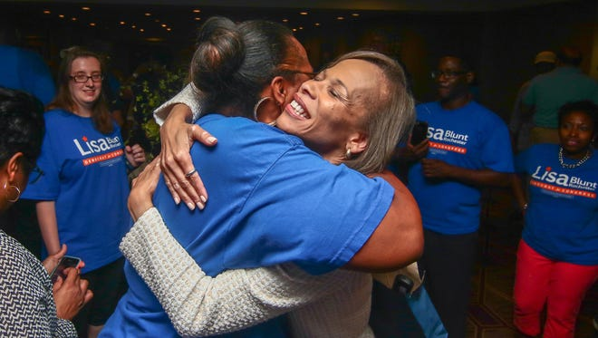 Lisa Blunt Rochester celebrates winning the Democratic nomination for U.S. House Tuesday in Wilmington. She finished with 44 percent of the vote.