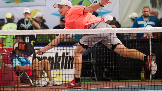 Fort Myers local Kyle Yates plays in the men's Pro division Pickleball Championship match during the first day of the 2018 U.S. Open Pickleball Championships at East Naples Community Park Sunday, April 22, 2018 in Naples.